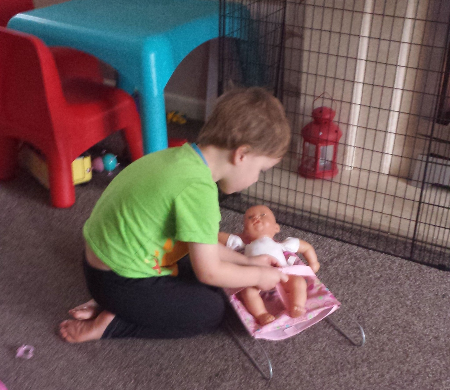 mckenzie playing with baby doll in preparation for a new sibling