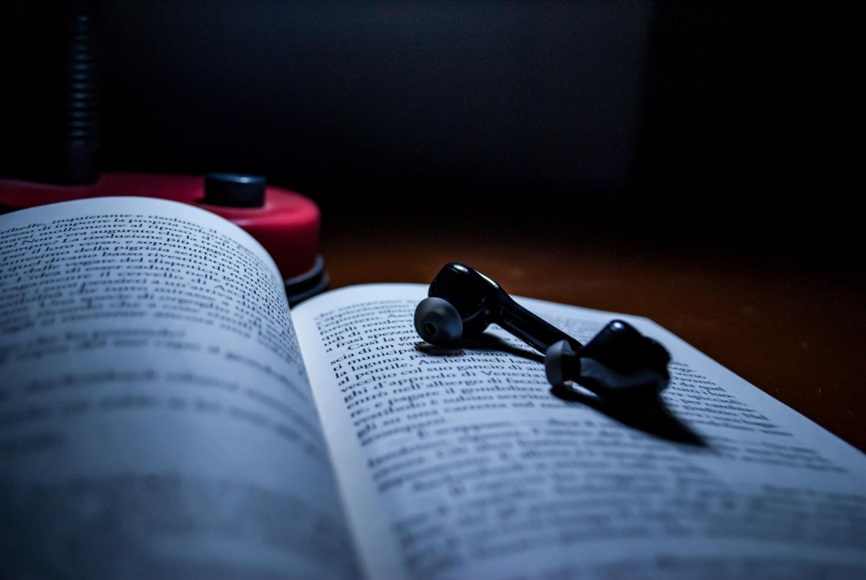 open book with earphones